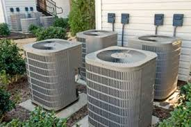 4 air con units outside a house
