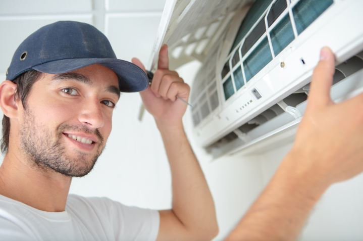 man handling air filter