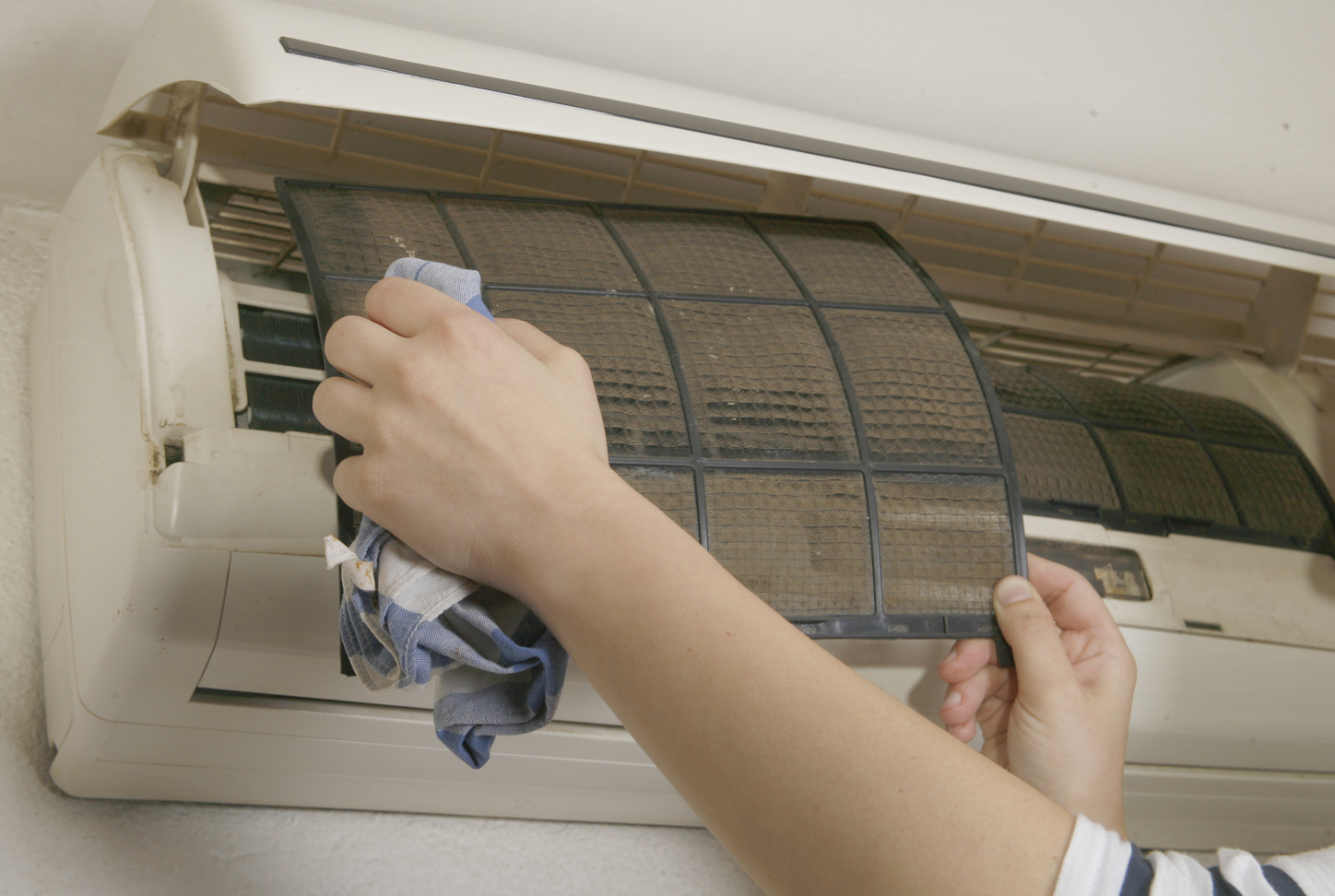lady cleaning ac filter