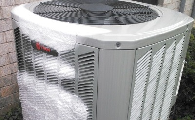 an air conditioning unit with ice on it