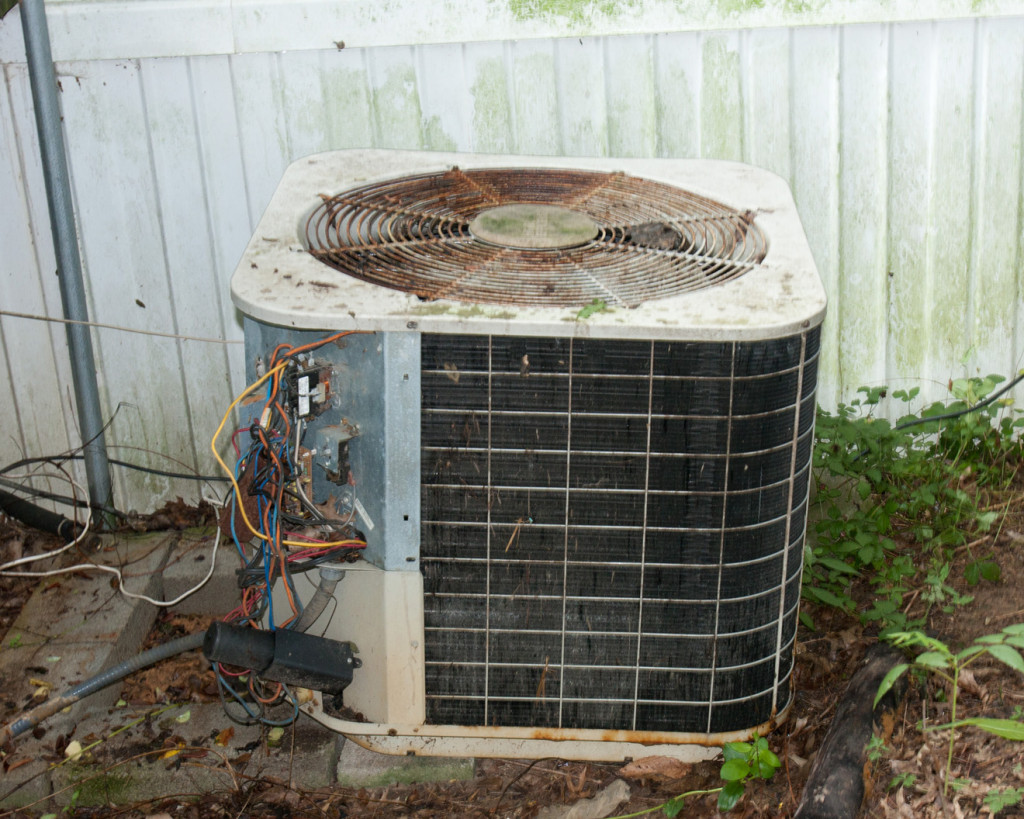 an old and rusting condenser unit
